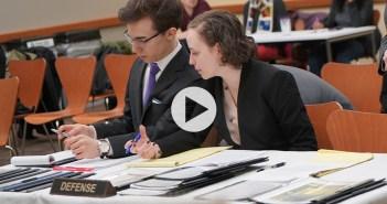 Mock Trial defense team confers
