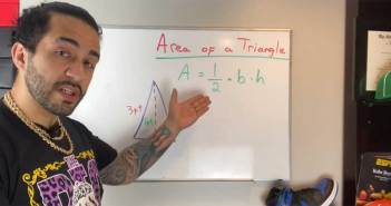 A man stands in front of a whiteboard