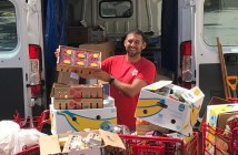Jon Stepanian, FCLC '06, loading a van with groceries to be distributed.