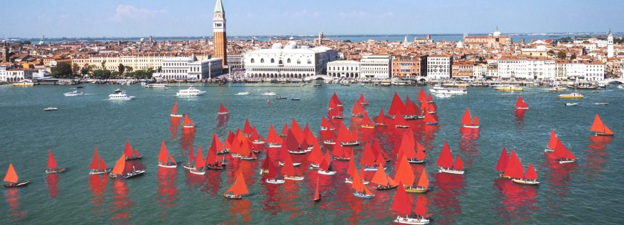 The Red Regatta sails through Venice's lagoon. Courtesy of Melissa McGill