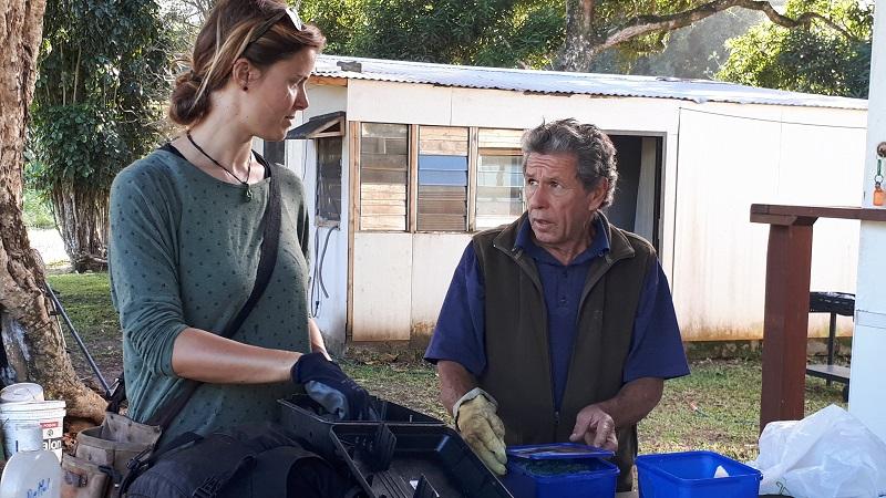 Ian Karika and Monica Evans preparing rat bait