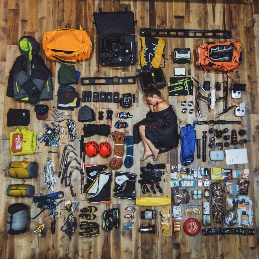 Rees among gear for an expedition with her husband and co-filmmaker Renan Ozturk. Courtesy of Taylor Rees