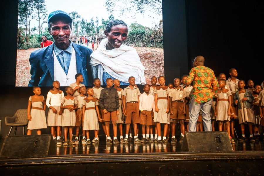Schoolchildren sing about climate change and restoration on stage. Musah Botchway, Global Landscapes Forum