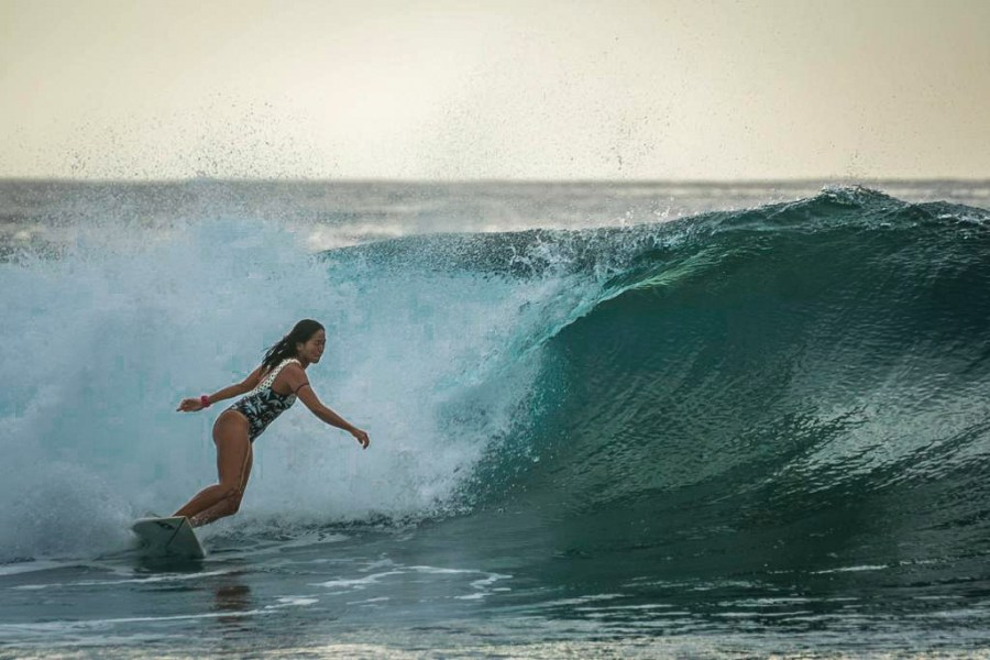 Abad surfing in Siargao. Courtesy of Marja Abad