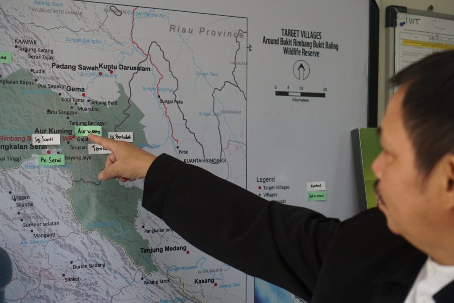 Mr. Fachruddin looks at a map of Riau, an Indonesian province on the Strait of Malacca that was fiercely affected by 2019's fire season. Courtesy of Fachruddin Mangunjaya