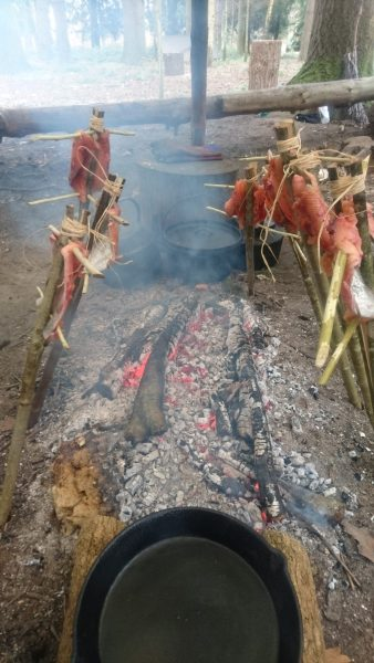 Cooking rainbow trout over the fire during the bushcraft course. David Charles