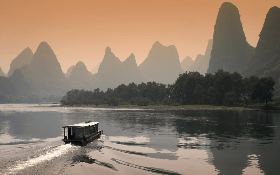 A skyline of limestone karst over the Li River in Guilin, China. 一元 马, Flickr