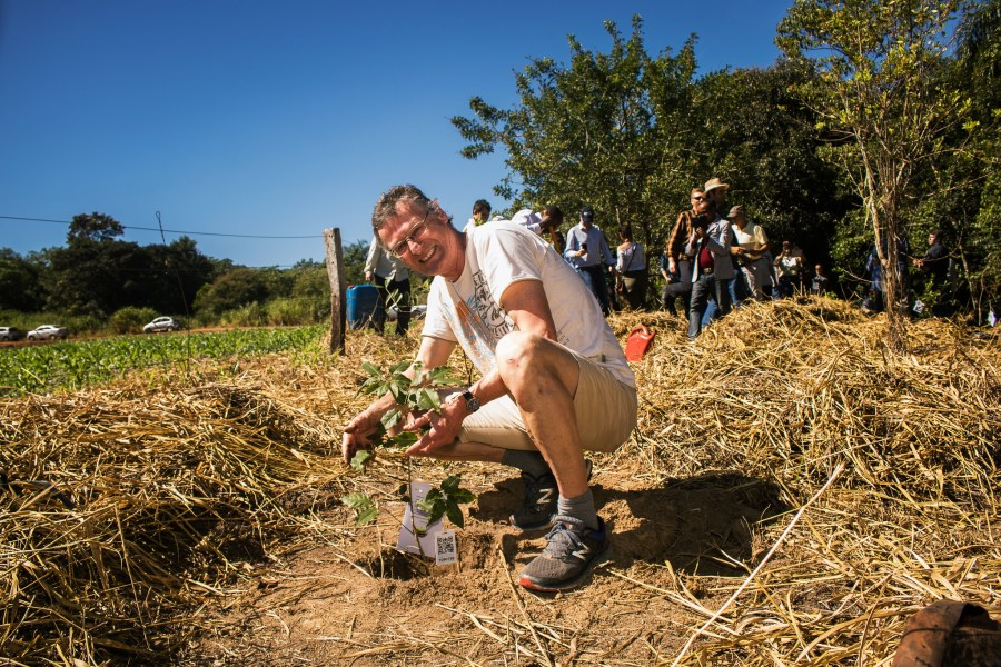 Horst Freiberg, creator of the Bonn Challenge, plants trees in northern Brazil as part of the initiative. Raquel Maia Arvelos, CIFOR