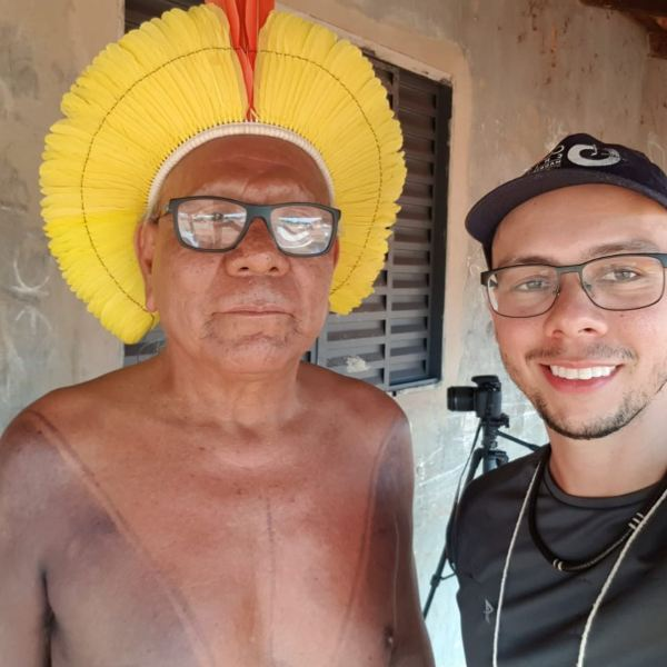 Rafael interviewing the late Indigenous Chief Paulinho Paiakan at the meeting of the 45 tribes. Courtesy of Rafael Forsetto