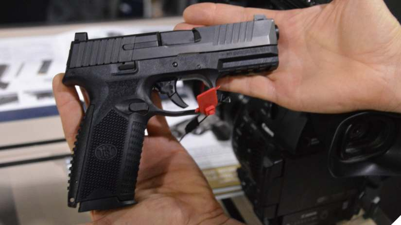 FN 509 pistol in a man's hands