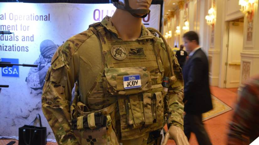 A mannequin wearing a plate carrier