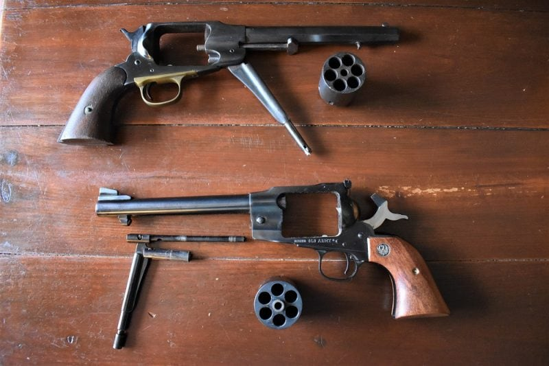 If you look closely at the Old Army, you will note that it has the flat-top and three-screw arrangement such as the original Ruger Blackhawks. Also, the Ruger uses a rounded barrel with much better sights rather than Remington's octagonal barrel.