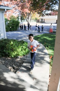 Second Graders Hand Deliver Colorful Painted Pumpkins to Neighbors