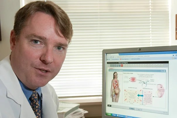 John Ross, a Brigham physician and HMS instructor, shows the new online interactive interface that allows doctors to order tests, examine results, and answer questions on where to delve next.