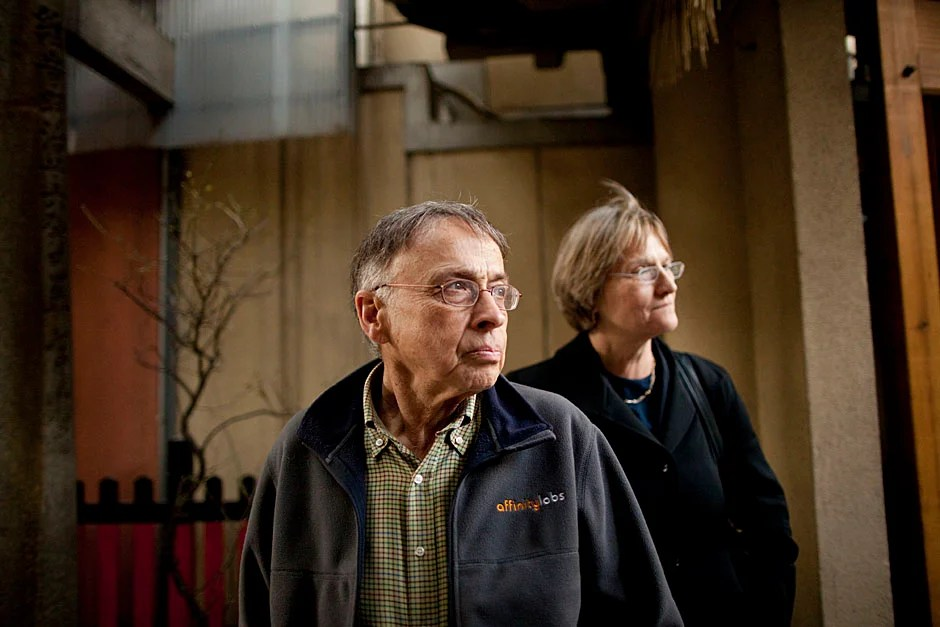 Charles Rosenberg and Drew Faust stroll through a marketplace.  Stephanie Mitchell/Harvard Staff Photographer