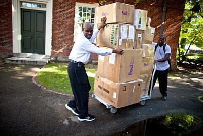 Freshman Terrance Moore (right) and his father Melvin move Terrance's boxes past Massachusetts Hall and into Straus Hall where Terrance will join the Class of 2014.