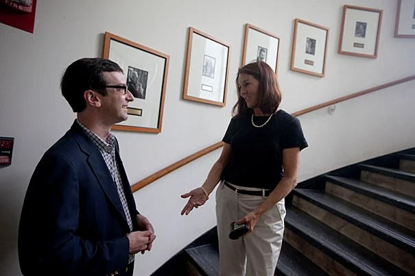 """""""Saving for retirement should not be like buying a lottery ticket,"""" says Robert I. Goldman Professor of Economics David Laibson, seen here with Patricia Boudrot, manager of financial administration in the Department of Economics."""