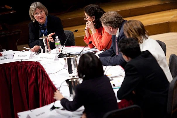 """Ten years after the Human Genome Project completed the human genome's first draft, Harvard President Drew Faust (far left) hosted a panel discussion on the legacy of """"biology's moonshot.""""  The panelists included (from left) Margaret Hamburg, Eric Lander, M. Susan Lindee, Vamsi Mootha, and Vicki Sato."""
