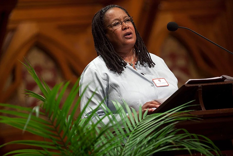 Evelynn M. Hammonds, dean of Harvard College, offers an official welcome to the families of the Class of 2014 inside Sanders Theatre. Hammonds began her tenure as dean of Harvard College on June 1, 2008 and is the first African-American woman to be appointed to that position. The late Archie Epps (1937-2003) was named assistant dean of Harvard College in 1964. He served as dean of students from 1971 to 1999 and was one of the first high-ranking African-American administrators at Harvard.