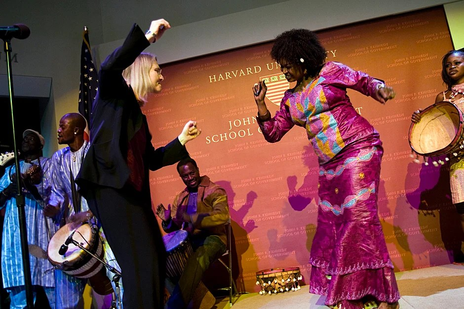 """Dec. 10, 2008. Ingrid Monson (left), Quincy Jones Professor of African-American Music, dances with Oumou Sangare, Mali's great diva and champion of women's rights, during a special performance at the Harvard Kennedy School forum """"Sixty Years of Human Rights."""" Photo by Stephanie Mitchell/Harvard Staff Photographer"""