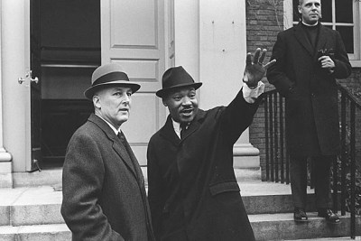 A well-known photo of Harvard President Nathan Pusey (left) and Martin Luther King Jr. at Harvard on Jan. 10, 1965. On Feb. 7, the Rev. Gregory Boyle, executive director of Homeboy Industries in Los Angeles, will deliver a keynote address honoring King's mission.