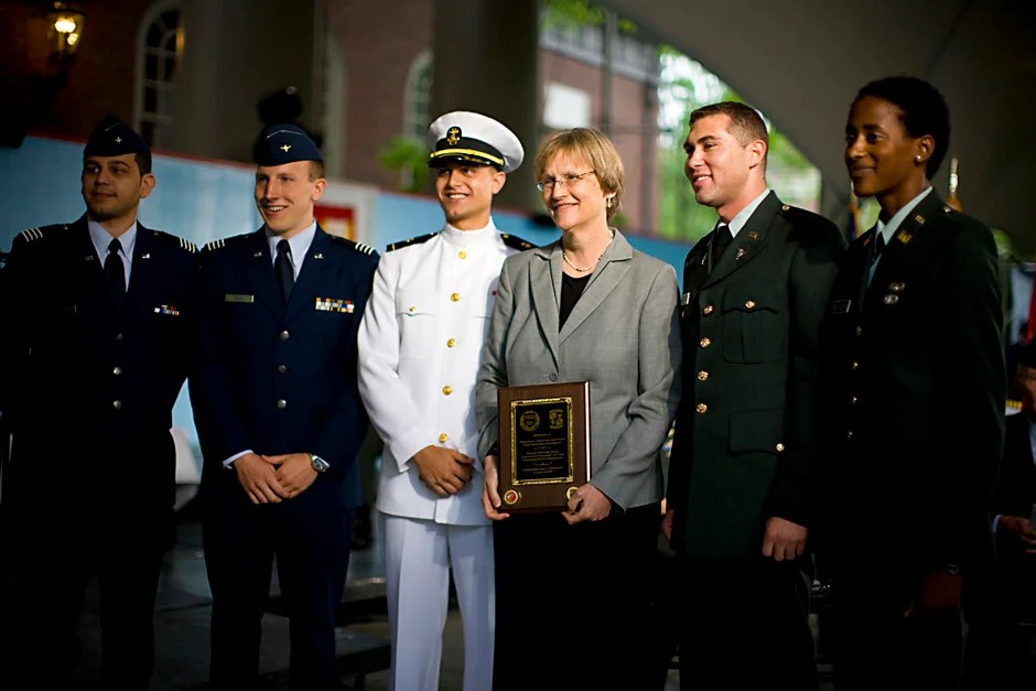 At the 2008 ROTC commissioning ceremony, Harvard President Drew Faust (center) poses with Reserve Officers' Training Corps members U.S. Air Force 2nd Lt. Roberto A. Guerra (from left) and 2nd Lt. Michael J. Arth; U.S. Navy Ensign John D. Reed; and U.S. Army 2nd Lt. Jason M. Scherer and 2nd Lt. J. Danielle Williams. Justin Ide/Harvard Staff Photographer