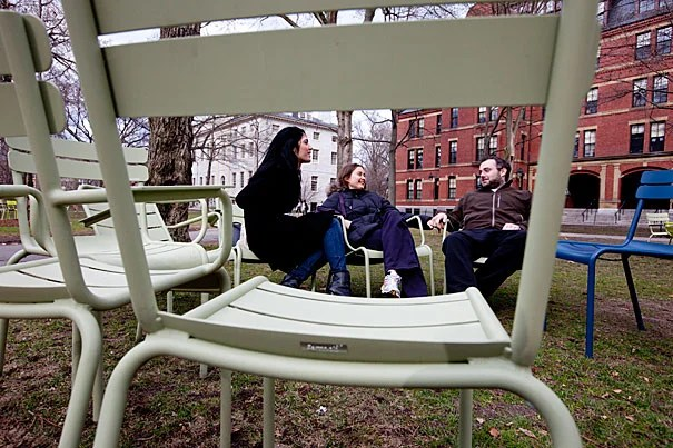 Carina Cappello (from left), Caroline Psutka, and Christopher Mejo relax in the colorful chairs recently returned to Harvard Yard.