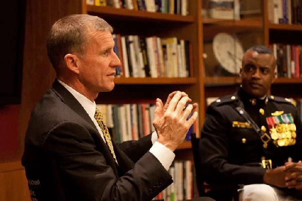 "Gen. Stanley McChrystal (left) and  Lt. Col. Jerry Carter spoke with the National Security Fellows at Harvard. McChrystal was the keynote speaker at an event recognizing Harvard's veterans.  ""I am very proud that President Faust has led the charge for a return of ROTC,"" he said in his address to the assembled veterans. ""We hope you learn something from us, but we know that you are among our best teachers."""