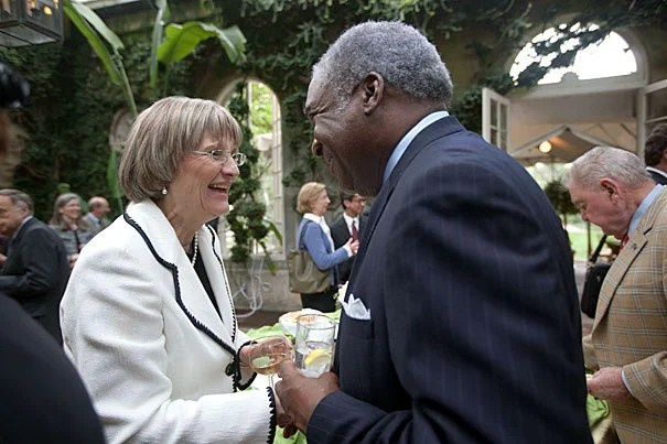 Harvard President Drew Faust speaks with Walter Morris '73, M.B.A. '75, during a reception at Dumbarton Oaks.