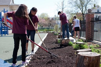 As part of Boston Shines, fifth-graders helped to clean and mulch the Gardner Pilot Academy's playground. It was a task that the academy didn't have staffing or resources to complete, according to school administrators.
