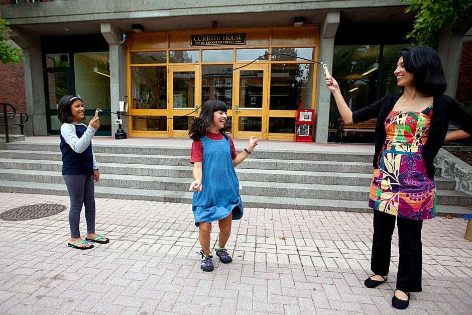 One of the youngest residents of Currier is Mara Cavallaro. Her parents, Nadejda Marques (right) and Jim Cavallaro, are Currier's House Masters. Her friend Autumn Galindo (left) holds the other end of the jump rope. Rose Lincoln/Harvard Staff Photographer