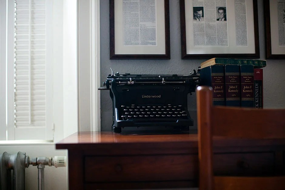 Articles and memorabilia from President Kennedy's time decorate the room. Stephanie Mitchell/Harvard Staff Photographer