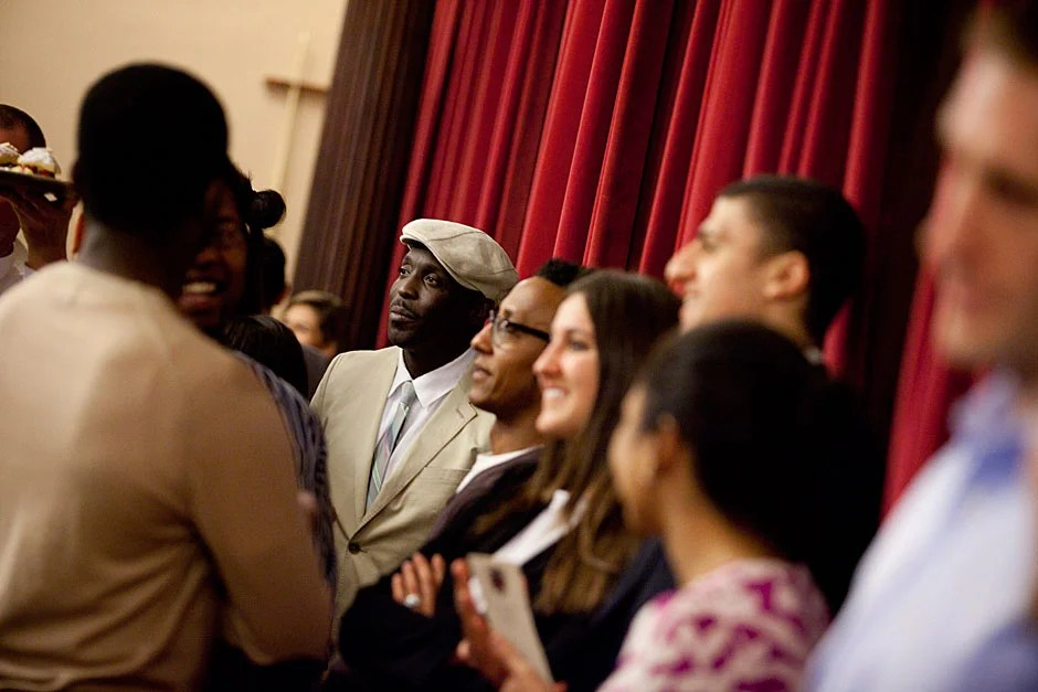 Michael K. Williams (center, in hat) and Andre Royo (in glasses), the actors who played Omar and Bubbles, respectively, speak to the gathered guests following the dinner. Stephanie Mitchell/Harvard Staff Photographer