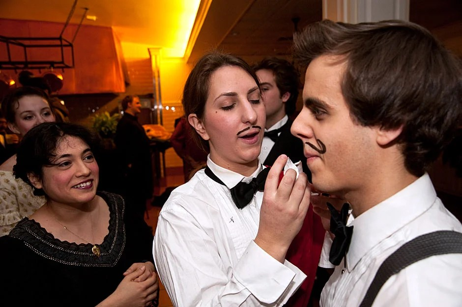 "Sofia Selowsky '12 applies makeup to Michael Cherella ' 11 before a performance of Johann Strauss' ""Die Fledermaus"" by the Dunster House Opera Society. Jon Chase/Harvard Staff Photographer"