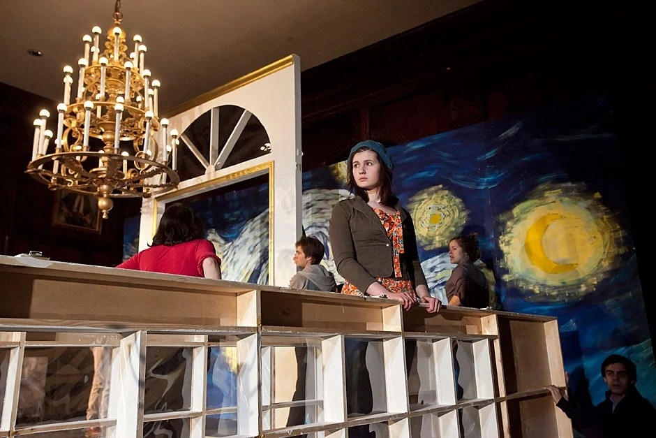 "The Dunster House Opera Society rehearses ""Die Fledermaus"" by Johann Strauss. Allison Ray '14 looks out from the set while waiting for additional stagehands to arrive. Jon Chase/Harvard Staff Photographer"