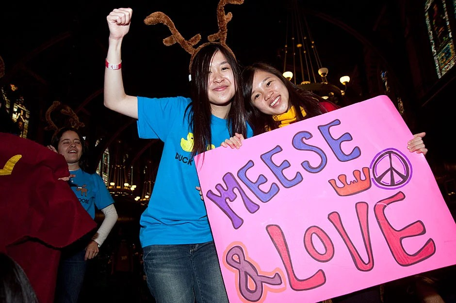 Dunsterites Anissa Mak '13 (left) and Melody Wu '13 (right) proudly proclaim their House allegiance as meese, their way of denoting the plural form of moose, the symbol of Dunster. Jon Chase/Harvard Staff Photographer