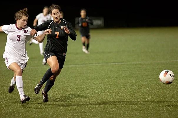 Harvard's Meg Casscells-Hamby '15 battles with Princeton's Kalie Bartholomew '12. Harvard beat Princeton 2-1 and has two games left in the season.
