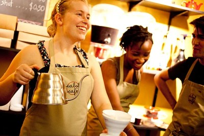 Anna Menzel '15, (from left), Marie-Fatima Hyacinthe '14, and Nicolas Jofre '13 serve coffee at the Cabot Cafe located in the basement of Cabot House.