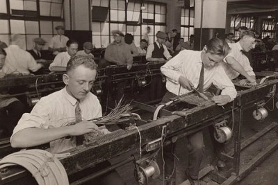 In 1924, Western Electric began conducting experiments to test ways of improving workers' productivity. This photo shows the factory cabling department, ca. 1925. The experiments would eventually revolutionize the workplace.
