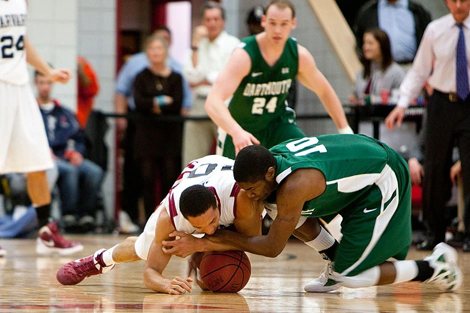 Harvard's Brandyn Curry (left) fights for a loose ball. Rose Lincoln/ Harvard Staff Photographer