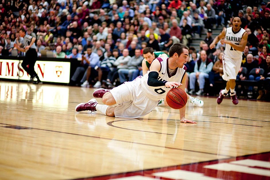 Harvard's Laurent Rivard looks around for help as he dribbles on his knees after grabbing a loose ball — and eluding the whistle.  Rose Lincoln/ Harvard Staff Photographer