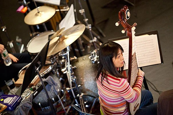 Wu Man with her pipa, a four-stringed instrument from China, during a rehearsal with the Silk Road Ensemble.