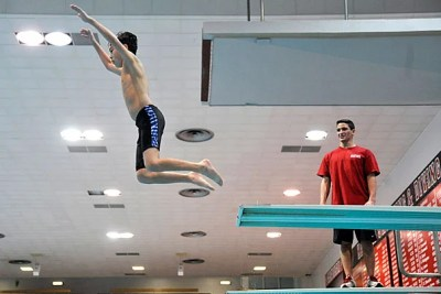 Diver and Olympic qualifier Mike Mosca '15 oversees burgeoning diver Thomas Choy, 15.