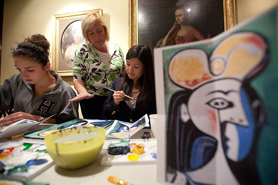 """Nicole Sliva '12 (from left), Quincy House Co-Master Deborah Gehrke, and Amy Sun '12 enjoy """"Deb's Paint Bar"""" inside the master's residence in Quincy House. Kris Snibbe/Harvard Staff Photographer"""