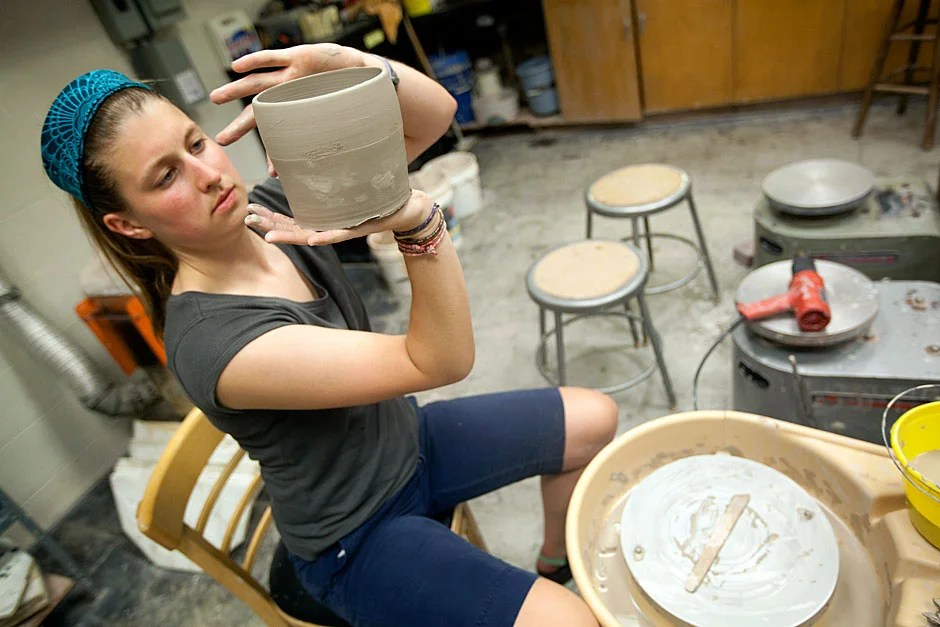 Caroline Lowe '12 works in the Quincy House pottery studio. Kris Snibbe/Harvard Staff Photographer