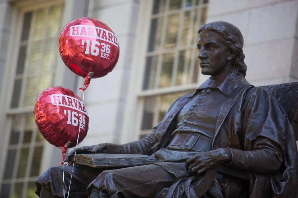What would John Harvard think of it all?  Not even balloons can break his permanently stoic face.