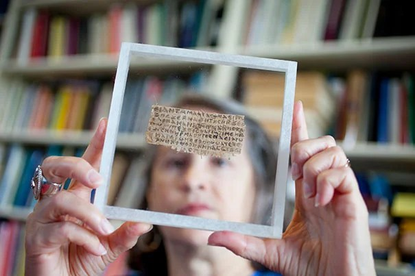 "Harvard Professor Karen King with the previously unknown papyrus fragment that, when translated, contains ""Jesus said to them, my wife.""  ""This new gospel doesn't prove that Jesus was married, but it tells us that the whole question only came up as part of vociferous debates about sexuality and marriage,"" said King."