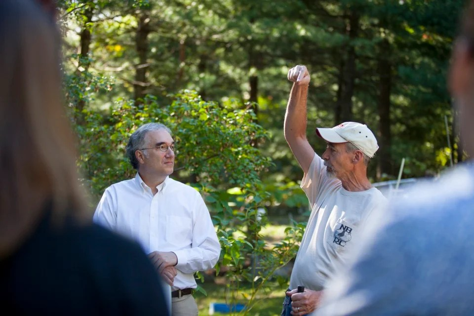 Spring (right), who has bred and raised his competitive birds for more than 50 years, describes the roll to Friedman, who is also Arnold Professor of Organismic and Evolutionary Biology at Harvard.