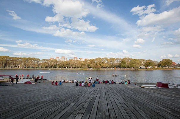 Spectators watch the Head of the Charles Regatta.