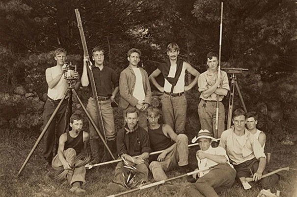 This 1902 photograph shows a group of rugged-looking students at a Harvard engineering camp at Squam Lake, N.H. On Oct. 1, the Harvard School of Engineering and Applied Sciences celebrated the 50th anniversary of ABET accreditation for its Scientiæ Baccalaureus (S.B.) degree in engineering sciences. ABET stands for Accreditation Board for Engineering and Technology.
